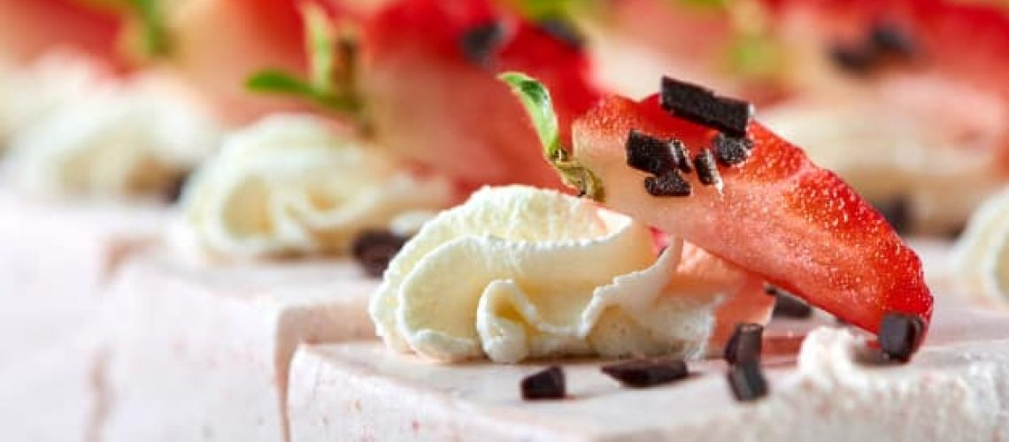delicious-restaurant-dessert-sweet-souffle-decorated-with-fresh-strawberry-grated-chocolate-whipped-cream-good-appetizer-light-wine-champagne_7502-5829