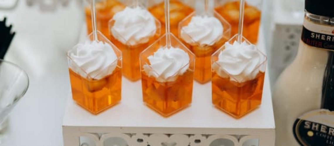 orange-jelly-desserts-with-whipped-cream-white-tray_8353-10637