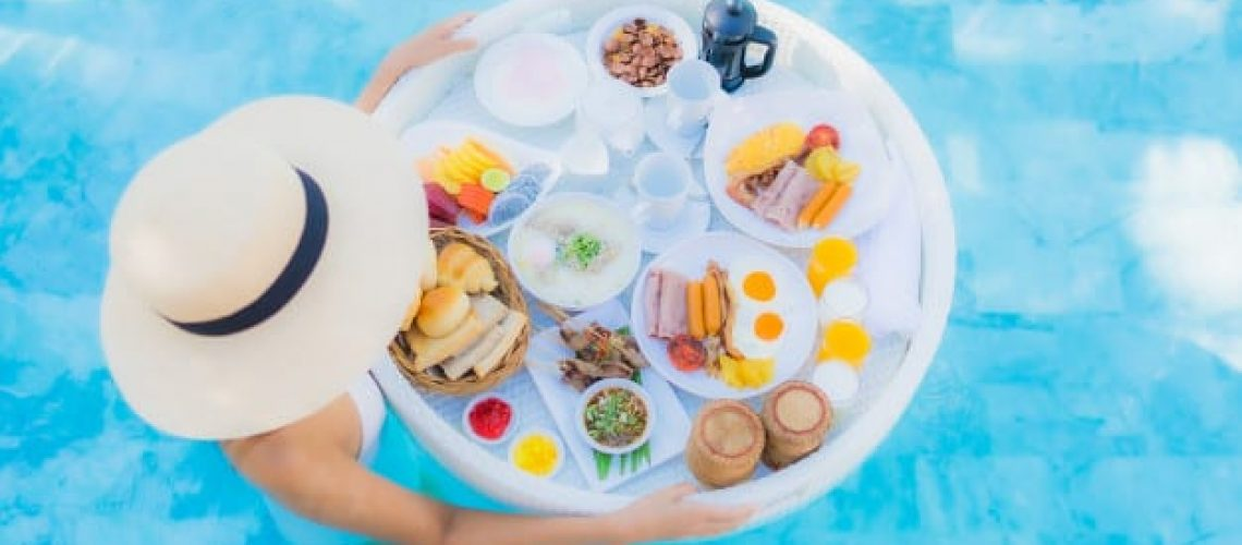 portrait-beautiful-young-asian-woman-happy-smile-with-floating-breakfast-tray-swimming-pool_74190-10167